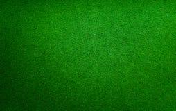 Una hierba artificial verde para los campos de deportes foto de archivo libre de regalías