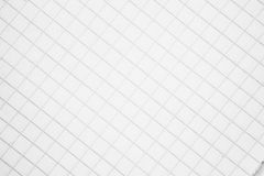 Una hoja de papel en un fondo de la jaula Imagen de archivo libre de regalías
