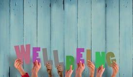 Una imagen compuesta de las manos que soportan bienestar Foto de archivo
