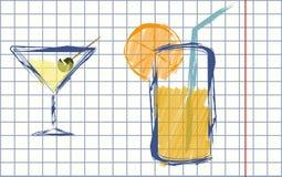 Una imagen con un vidrio de Martini y de zumo de naranja Fotografía de archivo libre de regalías