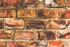 Una imagen de fondo del color de una pared de ladrillo vieja fotos de archivo