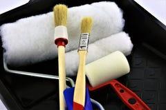 Una imagen del concepto de los cepillos de una pintura del hogar foto de archivo