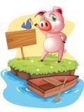 Una isla con un cerdo y un pájaro cerca de una señalización vacía Imágenes de archivo libres de regalías
