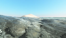 Una isla rodeada por el mar Foto de archivo libre de regalías