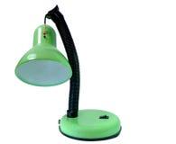 Una lámpara de mesa verde rota vieja en aislado foto de archivo