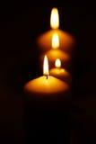 Una línea de velas Fotos de archivo libres de regalías
