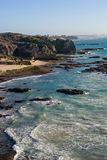 Una linea costiera rocciosa Immagine Stock