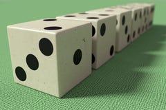 Una linea di sei dadi in primo piano Fotografia Stock Libera da Diritti