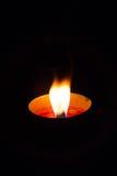 Una luz de la vela fotos de archivo