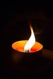 Una luz de la vela imagen de archivo libre de regalías
