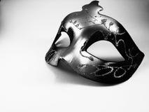 Una máscara blanco y negro imágenes de archivo libres de regalías