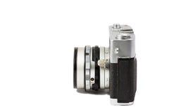 Una macchina fotografica della pellicola su priorità bassa bianca Immagine Stock