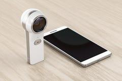 una macchina fotografica e uno smartphone da 360 gradi Immagine Stock