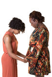 Una madre y su hija adolescente que ruegan Imagen de archivo libre de regalías