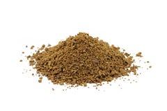 Una manciata di caffè istantaneo granulato Immagine Stock