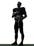 Mano dell'uomo del giocatore di football americano sulla siluetta del cuore Fotografie Stock Libere da Diritti
