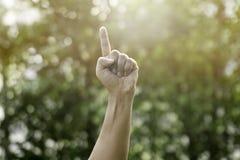 Una mano che indica il dito immagini stock