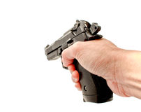 Una mano che tiene semi una pistola della tavola calda che indica in avanti Immagini Stock