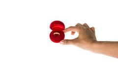 Una mano con il contenitore di anello Fotografia Stock Libera da Diritti