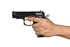 Una mano con la sola mano izquierda de la arma de mano Fotos de archivo libres de regalías