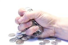 Una mano con las monedas fotografía de archivo