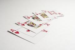 Una mano del rubor real que gana en póker Imagen de archivo libre de regalías