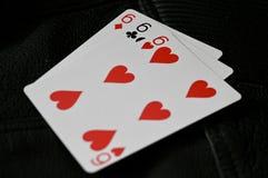 Una mano di 666 carte su fondo strutturato nero immagine stock libera da diritti