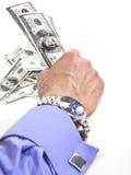 Una mano fuerte con el dinero foto de archivo libre de regalías