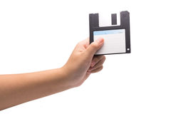 Una mano humana que sostiene 3 negros aislante manetic del disquete de 5 pulgadas Imagenes de archivo