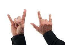 Una mano maschio dei due caucasian che fa un segno della roccia punk Immagine Stock Libera da Diritti