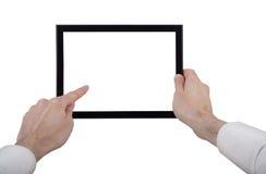 Una mano masculina que sostiene una PC del touchpad Fotografía de archivo libre de regalías