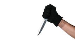 Una mano que sostiene la daga Aislado Fotografía de archivo libre de regalías