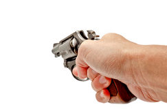 Una mano que sostiene un arma del revólver que señala adelante Imagen de archivo