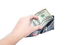 Una mano que sostiene un dinero con la cartera negra Fotografía de archivo