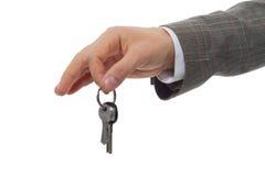 Una mano y una llave Imagenes de archivo