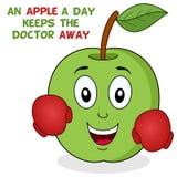 Una manzana al día mantiene al doctor ausente Imagen de archivo libre de regalías