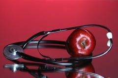 Una manzana al día mantiene al Dr. ausente fotos de archivo