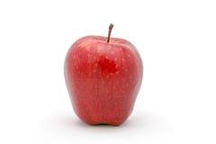 Una manzana en el foco aislado en un fondo blanco Fotos de archivo
