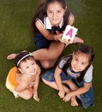 Una maschera di tre bambini Fotografie Stock Libere da Diritti