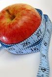 Una mela, promuovente i weightloss Immagine Stock Libera da Diritti