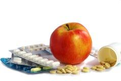 Una mela un il giorno mantiene il medico assente Immagine Stock