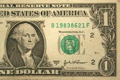 Una metà fronta dell'una fattura del dollaro Fotografia Stock Libera da Diritti