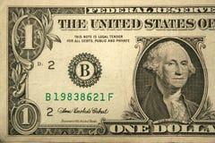 Una metà fronta dell'una fattura del dollaro Fotografie Stock
