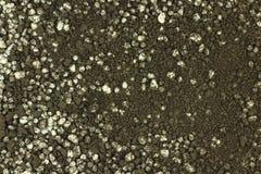 Una miscela dei granelli del fondo dell'humus e del fertilizzante Fotografia Stock