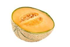 Una mitad del melón Foto de archivo libre de regalías