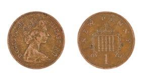 Una moneda del penique aislada Foto de archivo libre de regalías