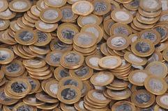 Una moneda real/moneda brasileña en el fondo blanco Fotografía de archivo libre de regalías