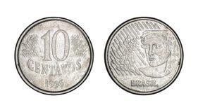 Una moneta reale brasiliana da dieci centesimi, parte anteriore e fronti posteriori - vecchie monete fotografia stock