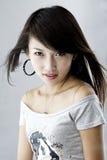Una muchacha asiática de moda Imagen de archivo