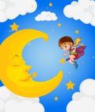 Una muchacha cerca de la luna el dormir Foto de archivo